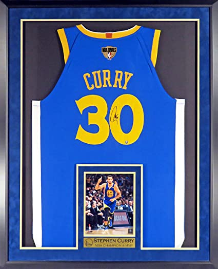53b99469758 GS Warriors Stephen Curry Autographed Road Blue Jersey w 2018 Finals Patch  (w Inset Photo  NBA CHAMPION   MVP Plate) Framed at Amazon s Sports  Collectibles ...