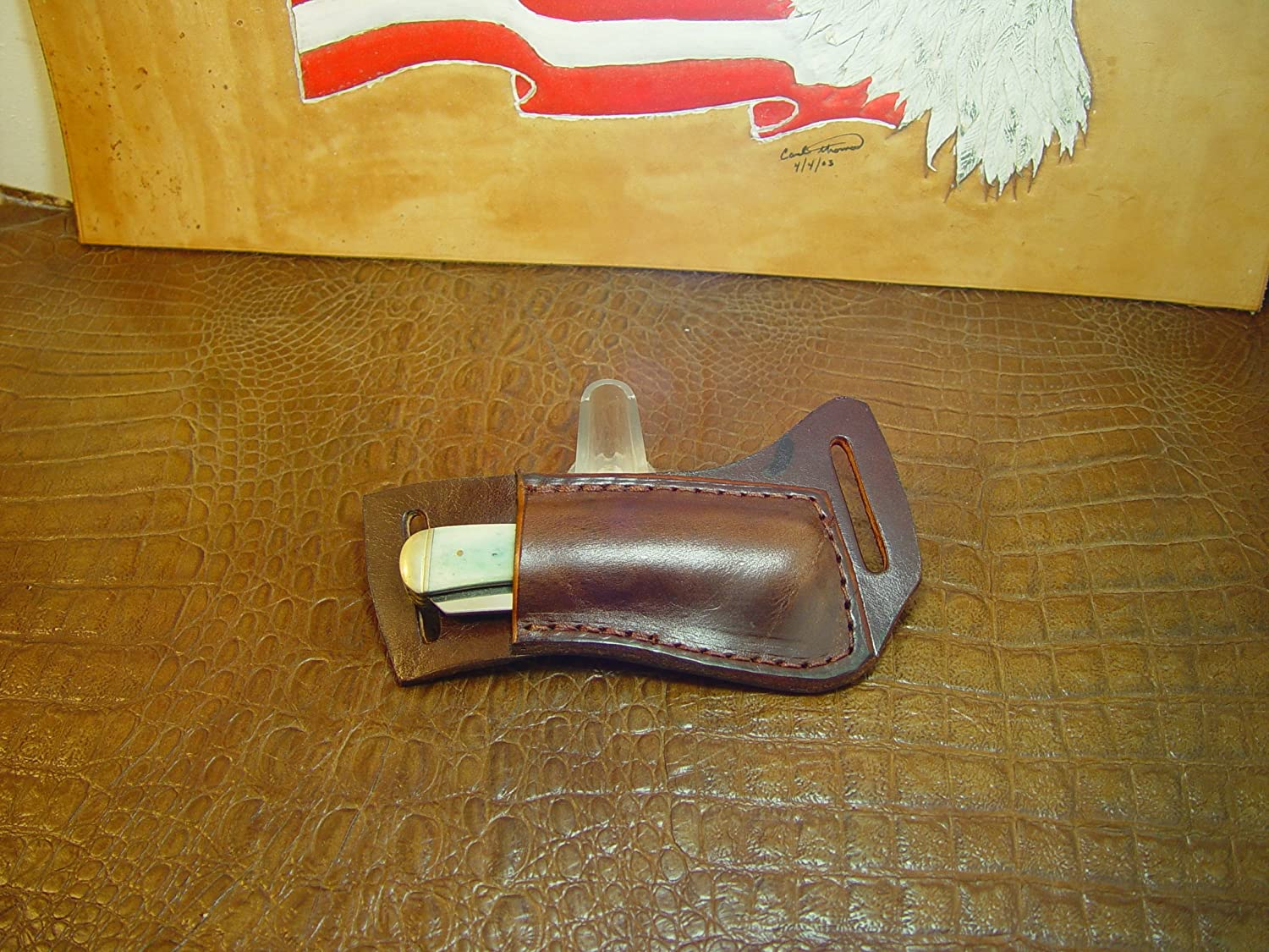 Custom Right-hand Cross Draw Trapper Style Folding Knife Sheath. Made Out of 10 Ounce Buffalo Hide Leather. Dyed Light Brown Sheath Only Knife Not Included.