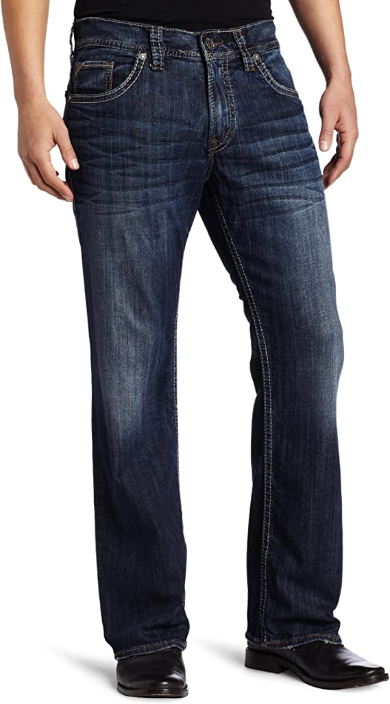 Model has worn dark indigo jeans with black shoes