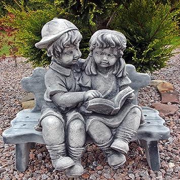 Steinfiguren Garten mädchen und junge auf bank steinfigur skulptur gartenfigur