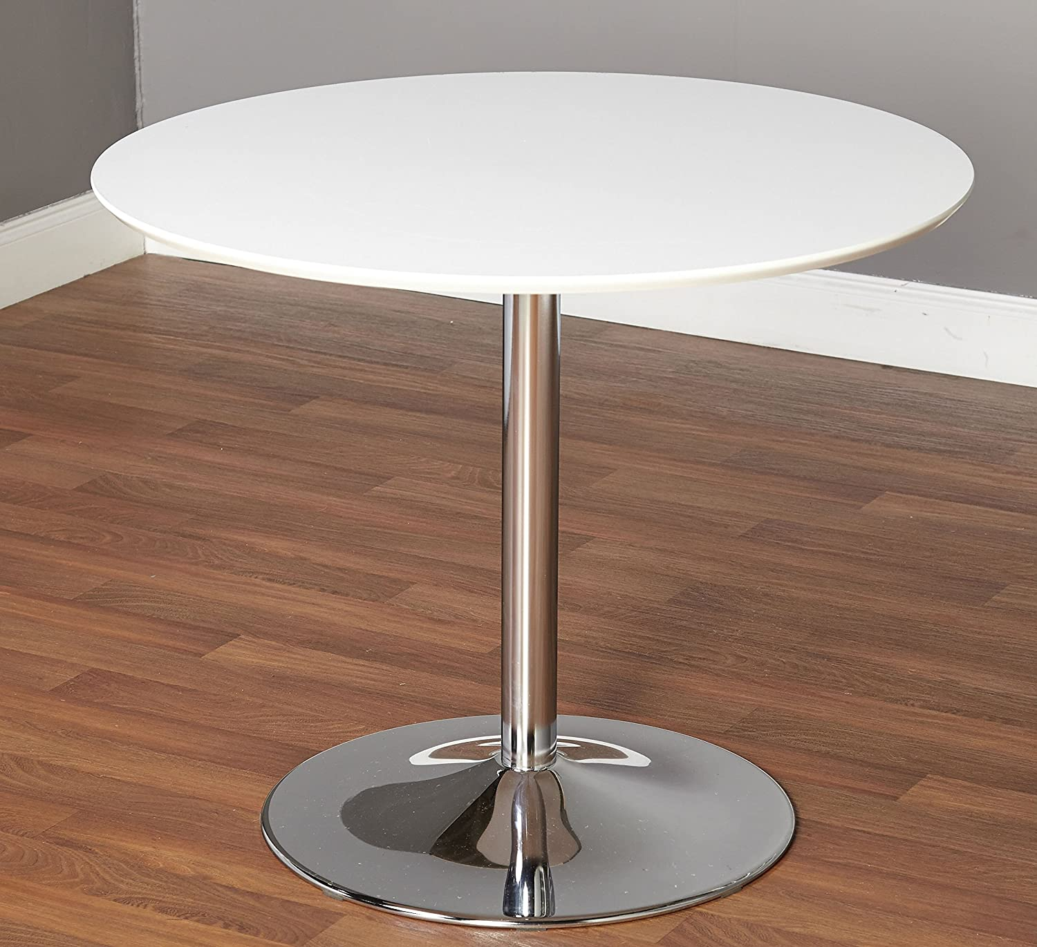 This Minimalist Dining Table - has a Compact Modern Design - with a White Round laminated table top and chrome base. Seats 4 -
