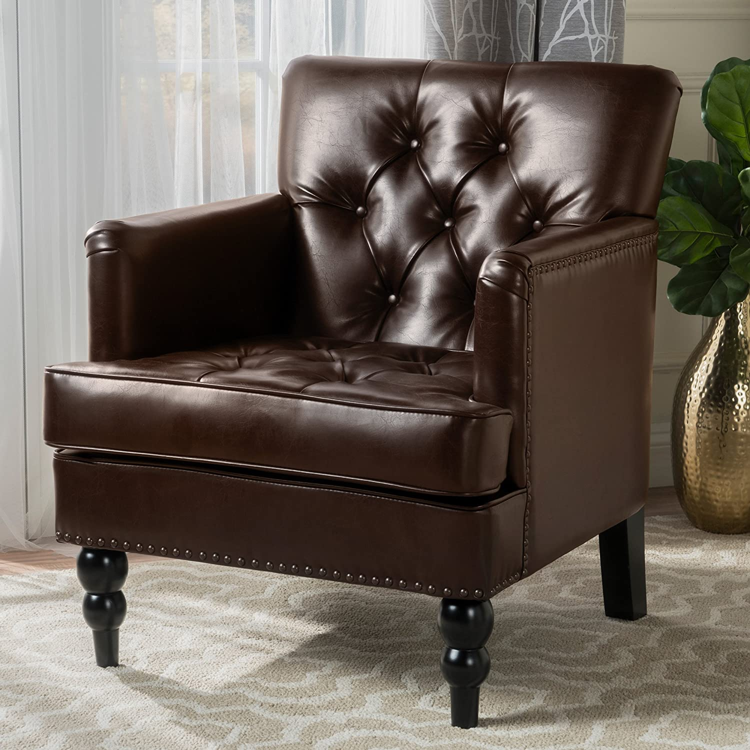 Christopher Knight Home 237354 The Denise Austin Vandor Bonded Features Studs, tufting, and Even Carved Wood Legs That denote only The Finest Elegance. This Medford Brown Leather Club Chair
