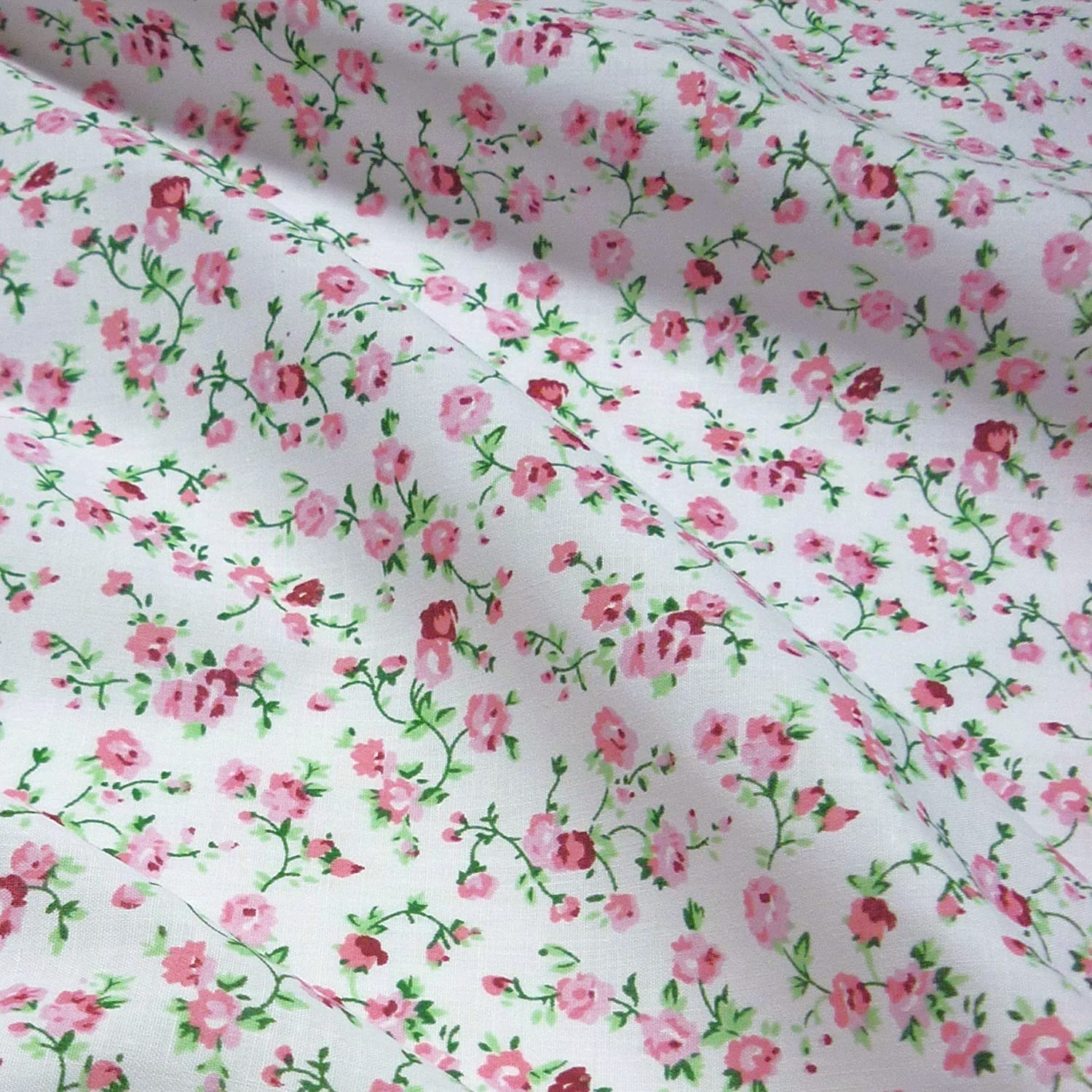 White Polycotton Fabric with Delicate Pink Flowers (Per Metre) Nortex Mill