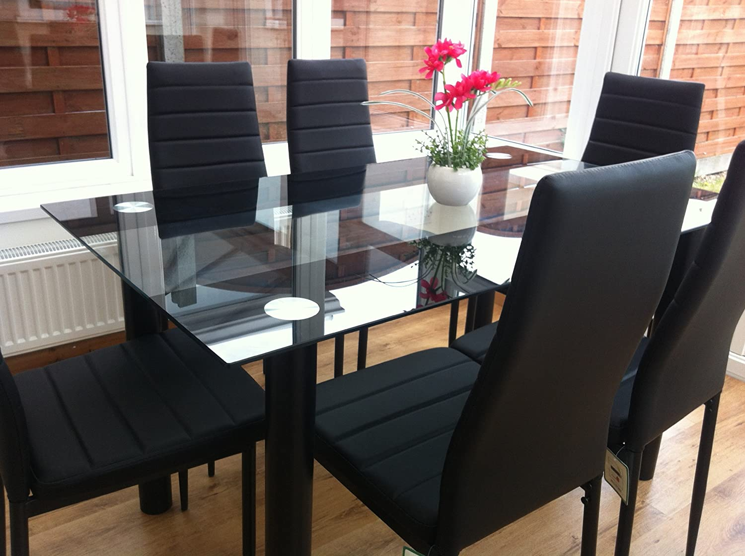 STUNNING GLASS BLACK DINING TABLE SET AND 6 FAUX LEATHER CHAIRS ...