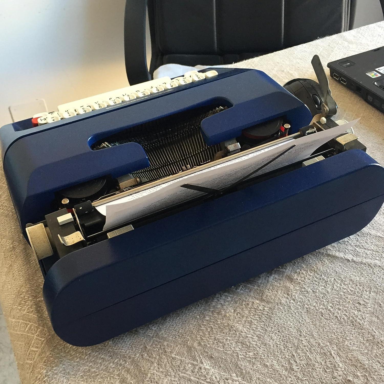 Máquina de escribir Olivetti plenamente operativo, color azul eléctrico elegante: Amazon.es: Oficina y papelería
