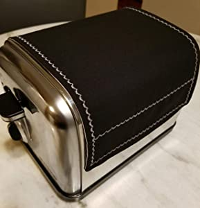 2 Slice Reversible Toaster Cover by Toaster Huggee® It will protect your open toaster slots by keeping dust & other airborne particles away!