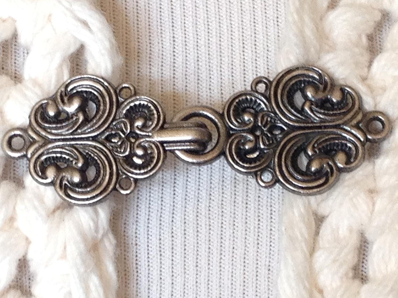 The mattie silver tone metal Celtic swirl sweater clip clasp