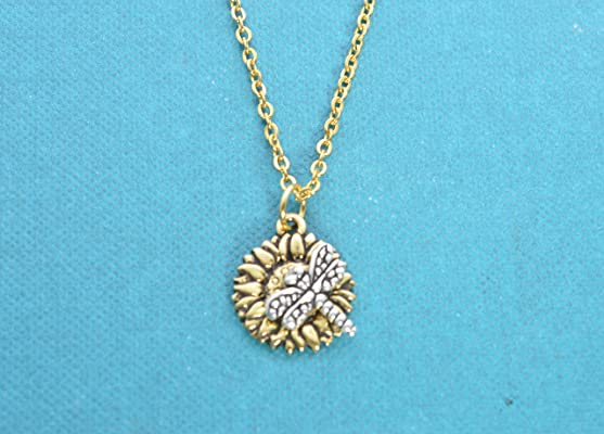 Dragon fly charm on gold plated pewter sunflower on an 18 gold stainless steel rolo chain. Dragonfly Necklace