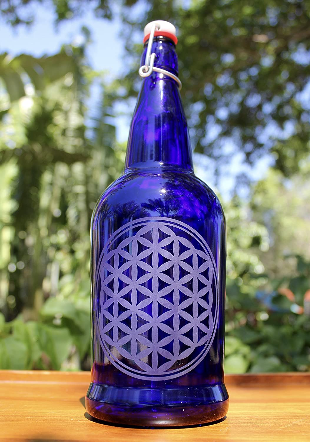 7116346622e7 32oz. Flower of Life Etched Cobalt Blue Glass Bottle with Swing-Top Lid
