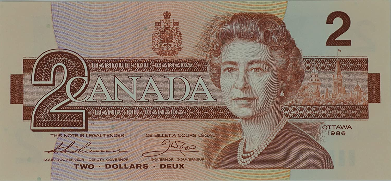 On a Canadian two dollar bill, the flag flying over the Parliament Building looks like an American flag, but is actually the flag that flew over to Dominion of Canada before the Maple Leaf .