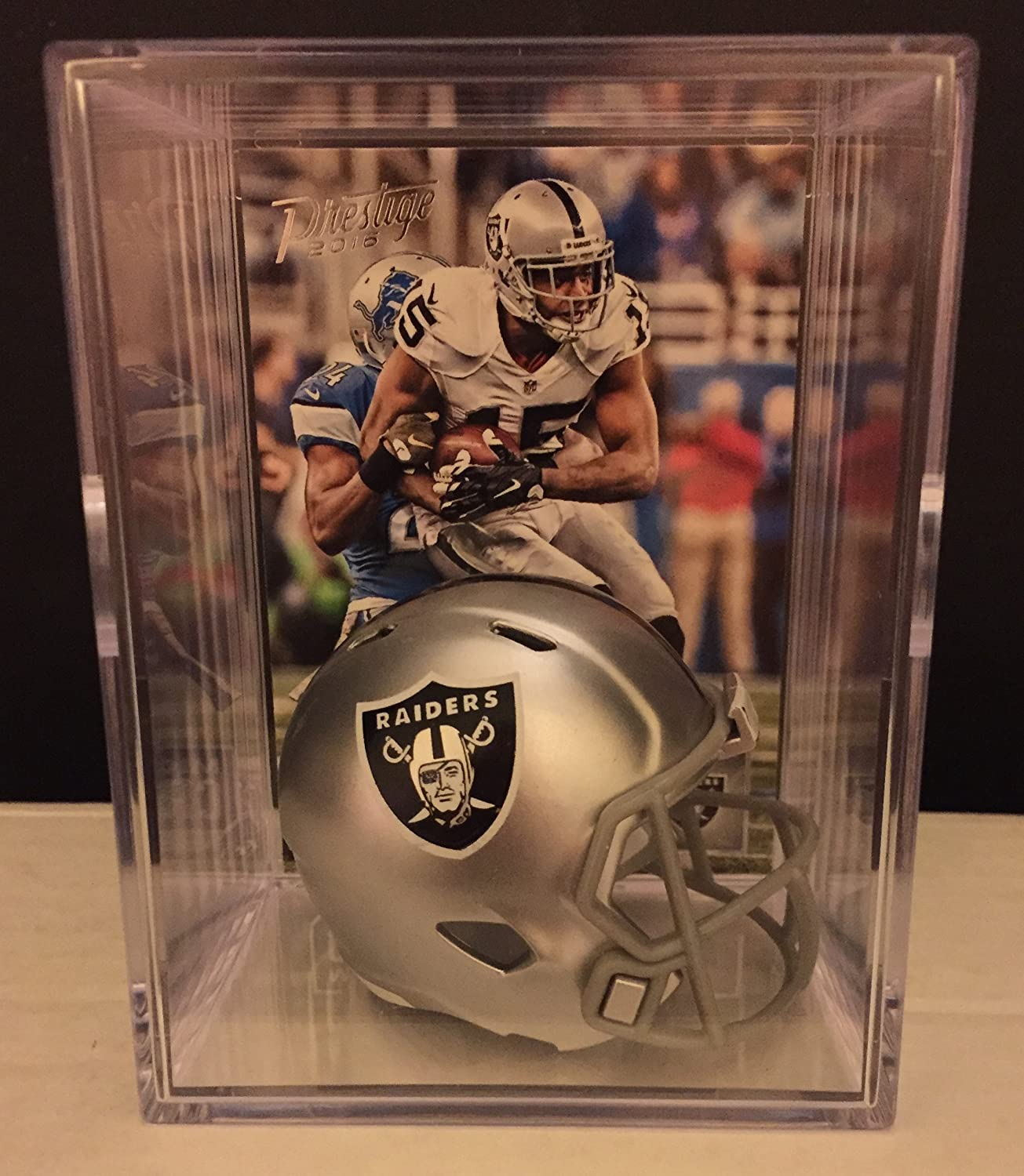 Amazon.com  Oakland Raiders NFL Helmet Shadowbox w  Michael Crabtree card   Sports Collectibles dd21cf3c7