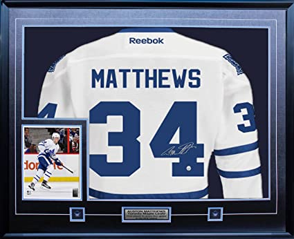 37d9bf891 Auston Matthews - Signed   Framed Leafs White Replica Jersey at ...