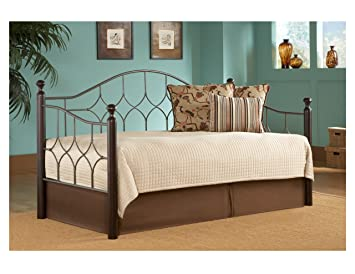 bianca metal daybed frame with arched back panel and espresso wood finial posts hammered pewter