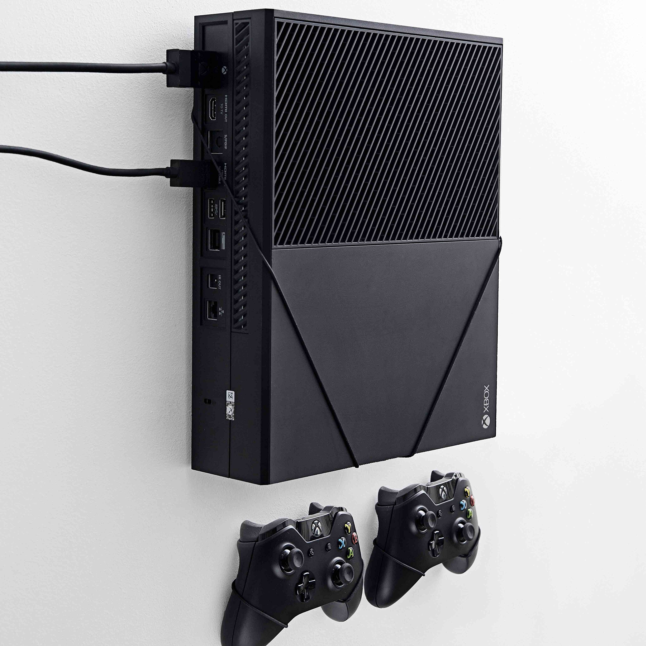 Wall mount for Xbox One Original by FLOATING GRIP® - This package (BUNDLE) incl. mounts for 1x console and 2x controllers. Color: Black. Patent pending and proprietary design by FLOATING GRIP® by FLOATING GRIP®