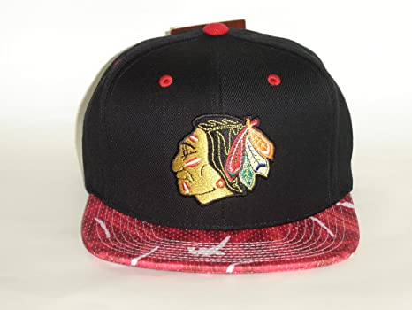 lowest price 6d304 442a0 Amazon.com   Mitchell and Ness NHL Chicago BlackHawks 2 Tone Paint Brush  Snapback Cap   Sports   Outdoors