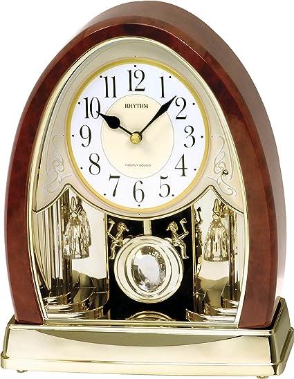 RHYTHM Reloj de mesa Chimenea Reloj Año Reloj con melodías Oro raíz de madera 7636: Amazon.es: Relojes