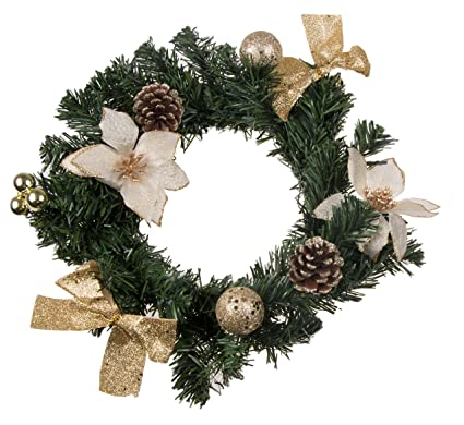 christmas wreath with white poinsettia snow covered pine cones gold bows and ornaments