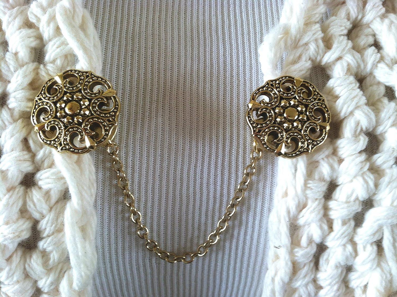 The mattie gold tone metal ribbon sweater clip clasp