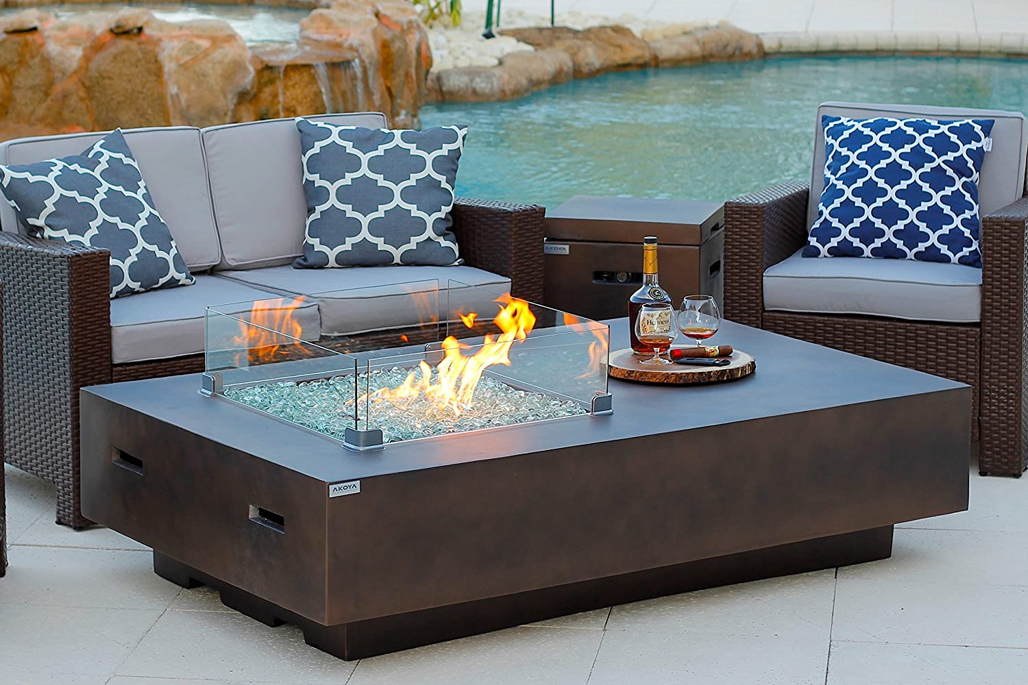 AKOYA Outdoor Essentials 65 Rectangular Modern Concrete Fire Pit Table w Glass Guard and Crystals in Brown 65 Brown, Caribbean Blue