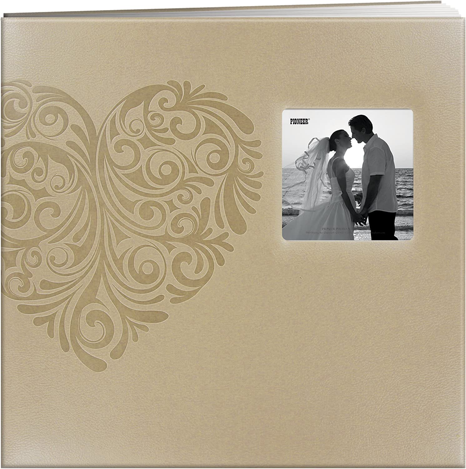 An image of a scrapbook photo album in leatherette frame cover with a heart intricate print at the front. .