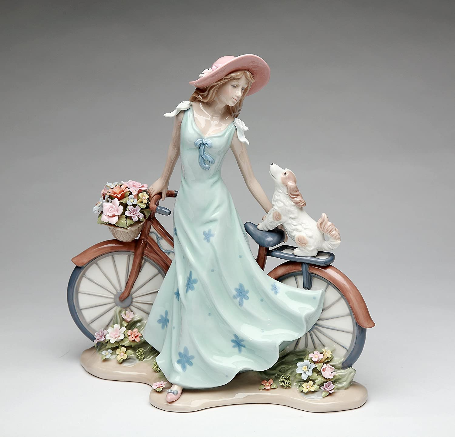 Amazon Com Cosmos Gifts 10414 Fine Elegant Porcelain Lady Riding Bike With My Best Friend Dog Puppy Porcelain Figurine 10 5 8 H Home Kitchen