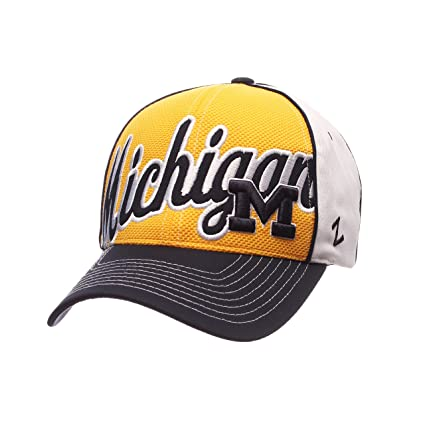 hot sale online 56a0a 0d0eb Image Unavailable. Image not available for. Color  ZHATS NCAA Michigan  Wolverines Men s Uprising Hat, White Navy, Adjustable