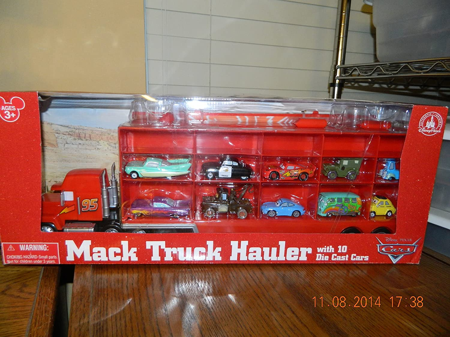 Amazon Com Disney World Of Cars Mack Truck Hauler With Cars