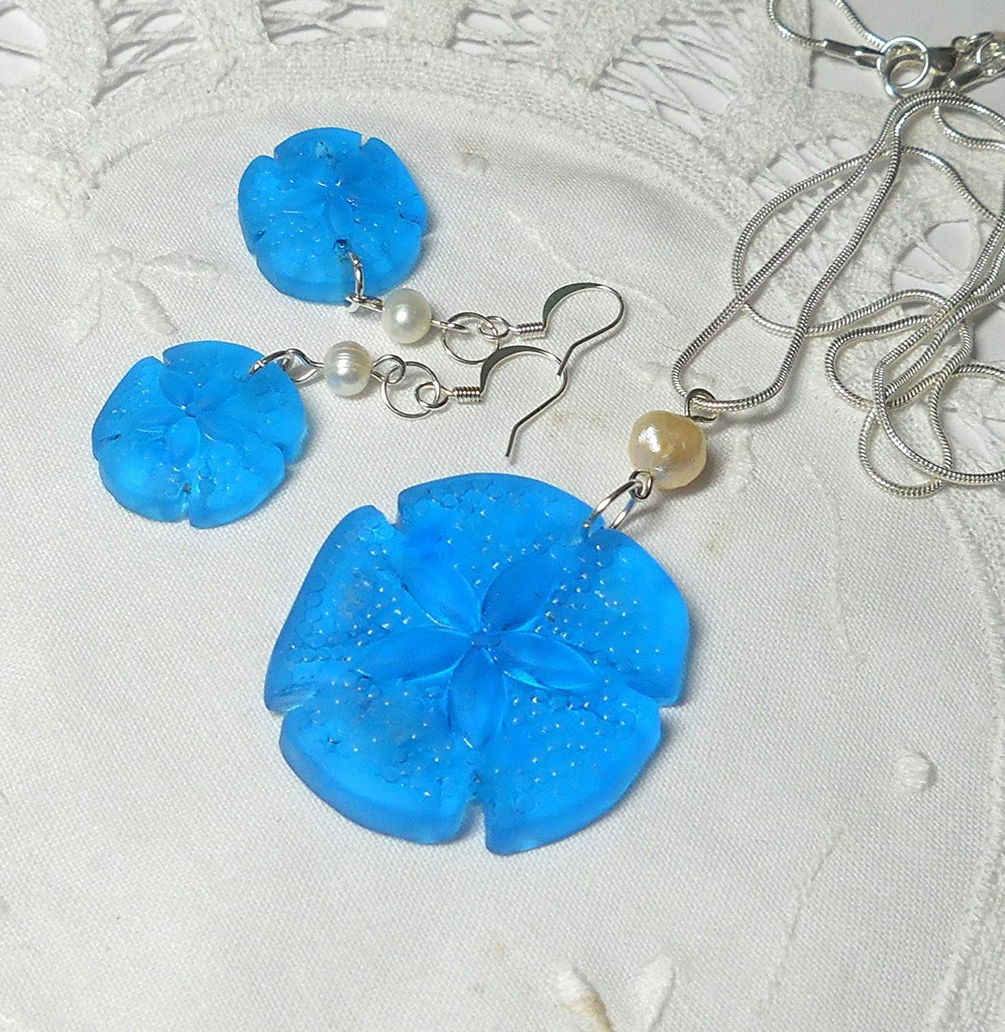 Light blue sea glass sand dollar pendant necklace and earrings set with pearls and silver by BethExpressions