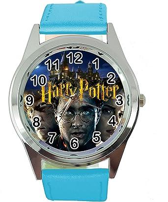 Todo para el streamer: TAPORT® Harry Potter Reloj de cuarzo redondo banda de cuero azul E2 + batería de repuesto + bolsa de regalo gratis