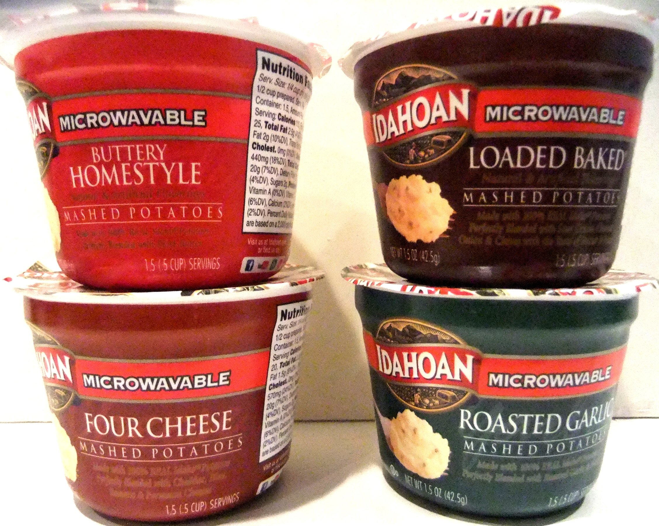 Idahoan Mashed Potatoes Microwavable Single Serve Cups VARIETY 16 PACK + FREE Pack of Heavy Duty Plastic Utensils. 4 Cups each of BUTTER HOMESTYLE, FOUR CHEESE, ROASTED GARLIC, LOADED BAKED (1.5 oz)