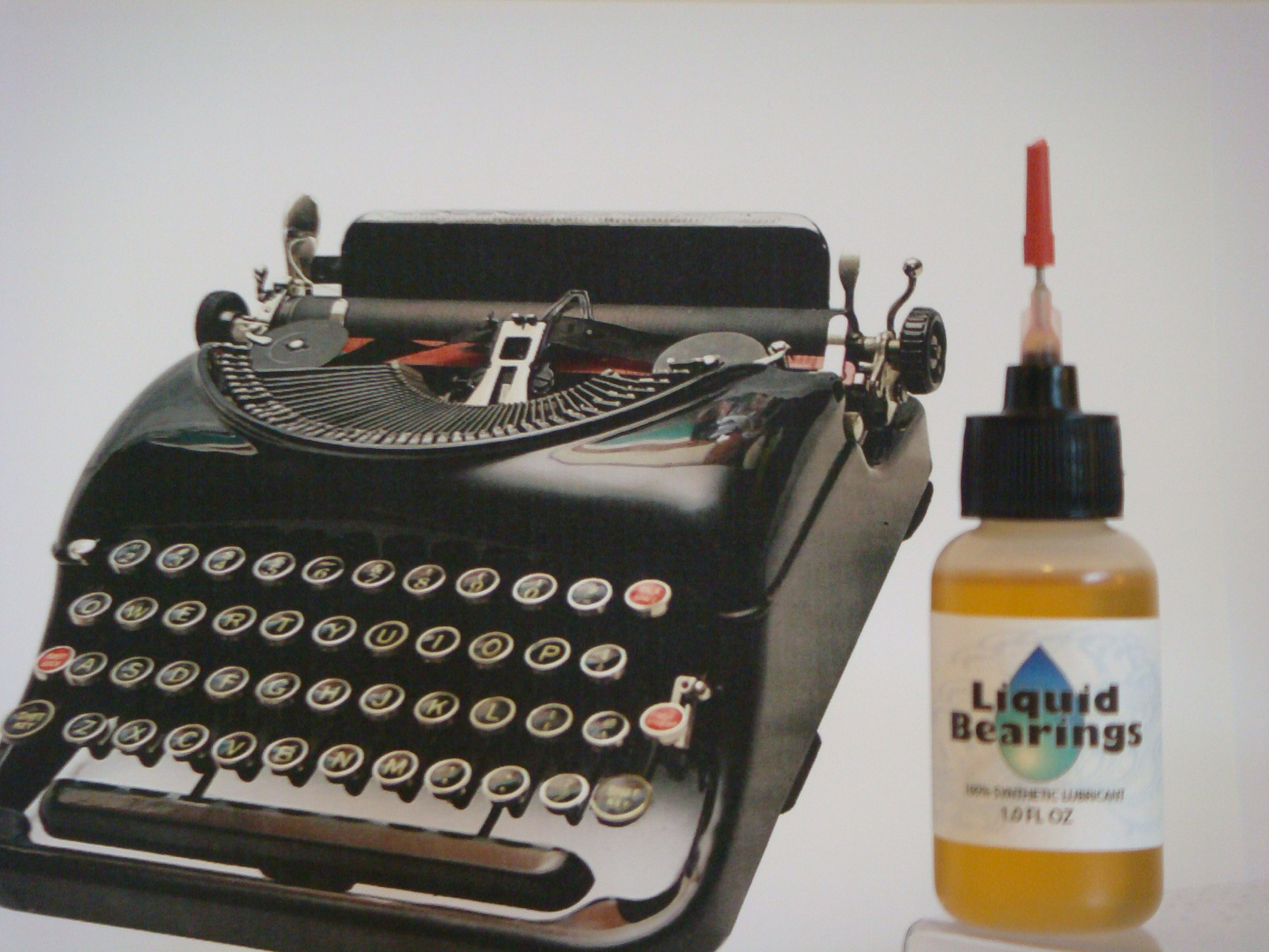 ULTIMATE 100%-synthetic oil for any typewriter, restores sticky keys, makes typewriters