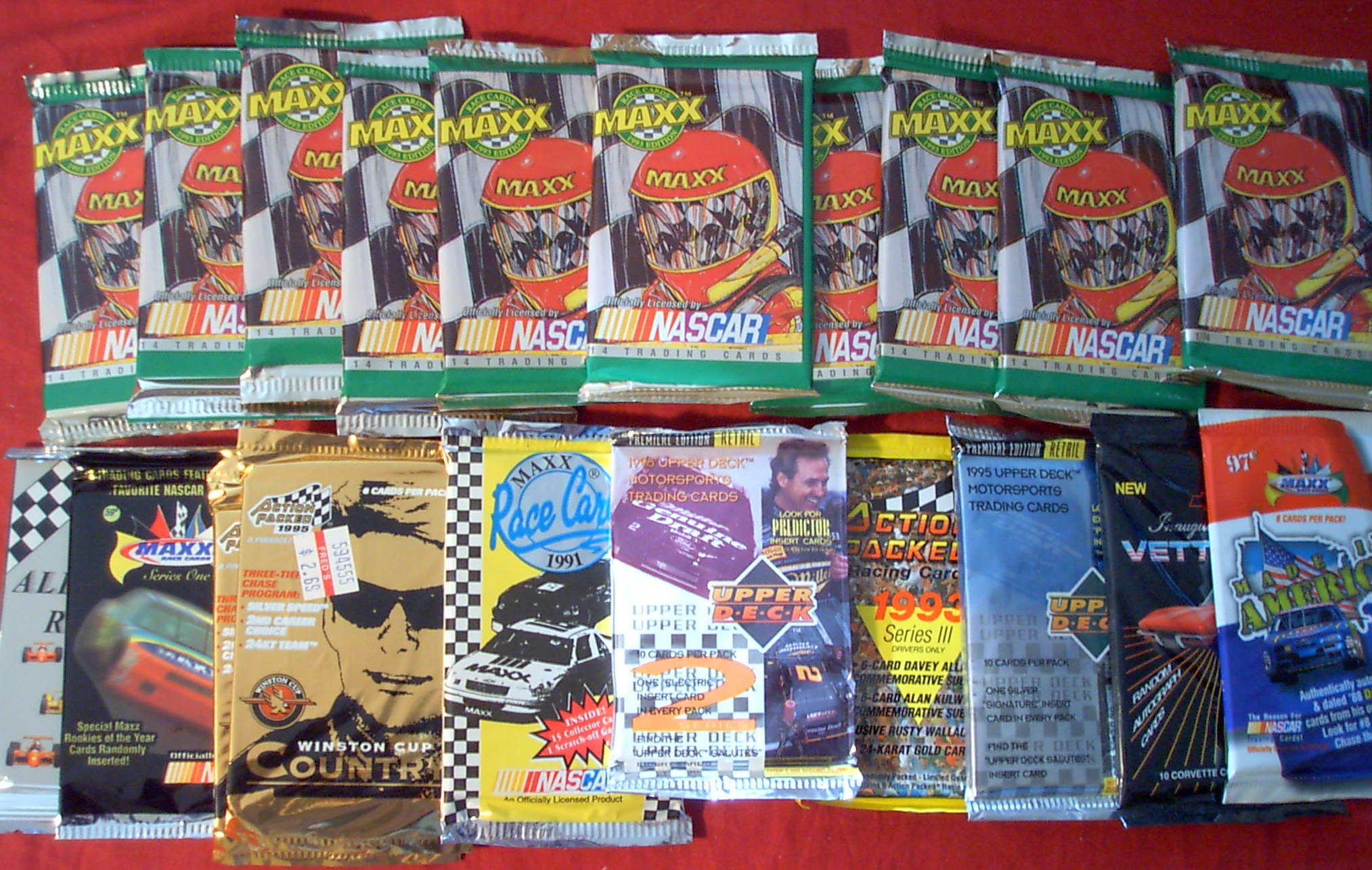 20 Original Unopened Packs of RACING NASCAR Cards (1991-1996) - Look for Dale Earnhardt. Jimmy Johnson. Mark Martin. Labonte and Jeff Gordon cards, special inserts, and more!! (PACKS ARE FUN TO OPEN)