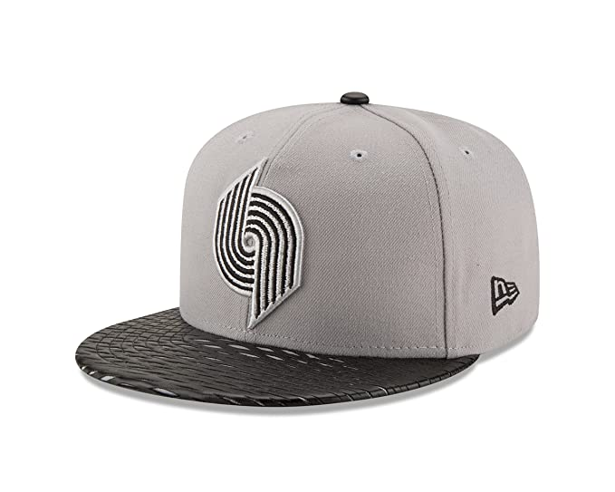 new product 289bc 07b7d Amazon.com   NBA Leather Rip 59FIFTY Fitted Cap   Clothing