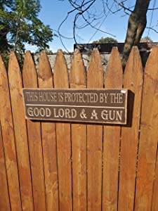 This House is Protected by The God and A Gun Brown Wood Sign Vintage Farmhouse Style Decor wooen Sign Best Gift for Wedding Housewarming and Living Room