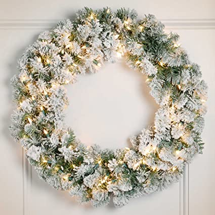 24 pre lit snowy pine flocked artificial christmas wreath clear lights