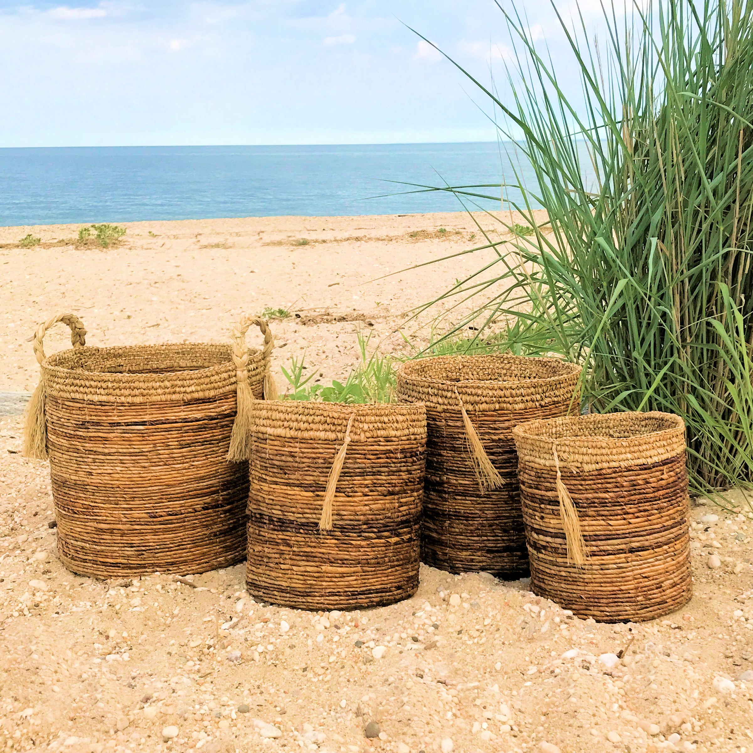 The Boho Beach House Tassel Baskets, Set of 4, Relaxed Coastal Style, Woven Banana Leaf and Sisal 3 Barrel and 1 Oversized Top-handled, (Various Sizes) By Whole House Worlds