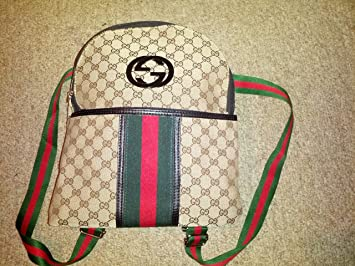 f31b7e084bd Amazon.com   Gucci Backpack Made in Italy   Cosmetic Tote Bags   Beauty