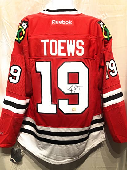 54c1a11f666 Jonathan Toews Chicago Blackhawks Signed Autograph Reebok Jersey Frameworth  Hologram Certified at Amazon's Sports Collectibles Store