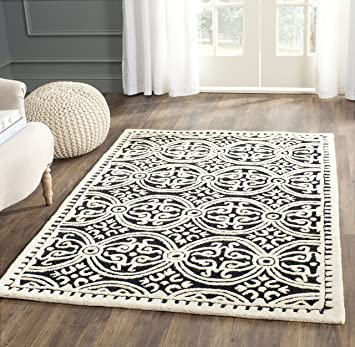 Amazon Com Safavieh Cambridge Collection Cam123e Handmade Moroccan Premium Wool Area Rug 4 X 6 Black Ivory Furniture Decor