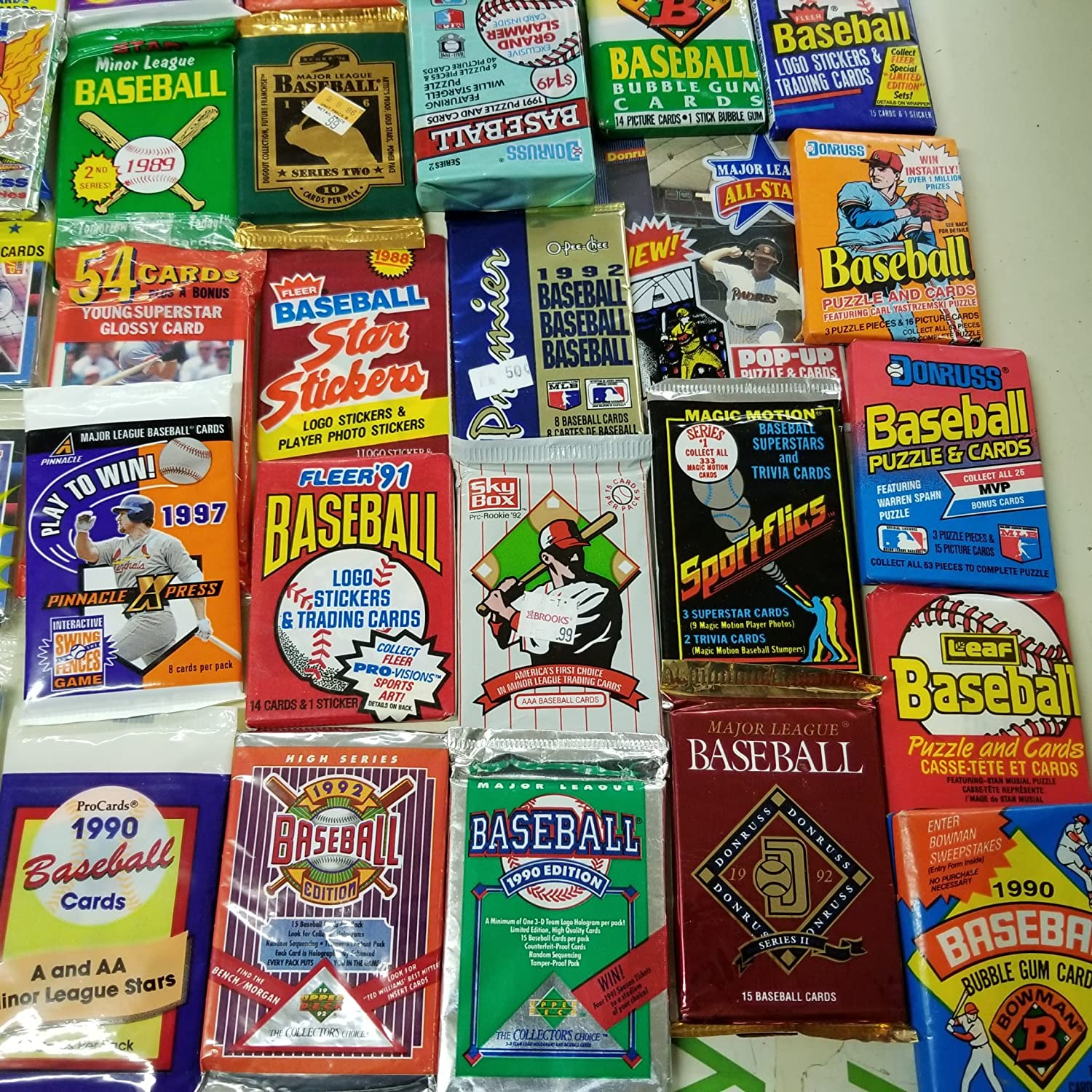 50 Original Unopened Packs of Vintage Baseball Cards - Look for rookie cards special inserts hall of famers and more!! 1986-1994