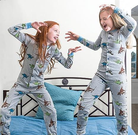 Dinosaurio juego de Unión pijamas T-Rex en la aleta posterior: Amazon.es: Ropa y accesorios