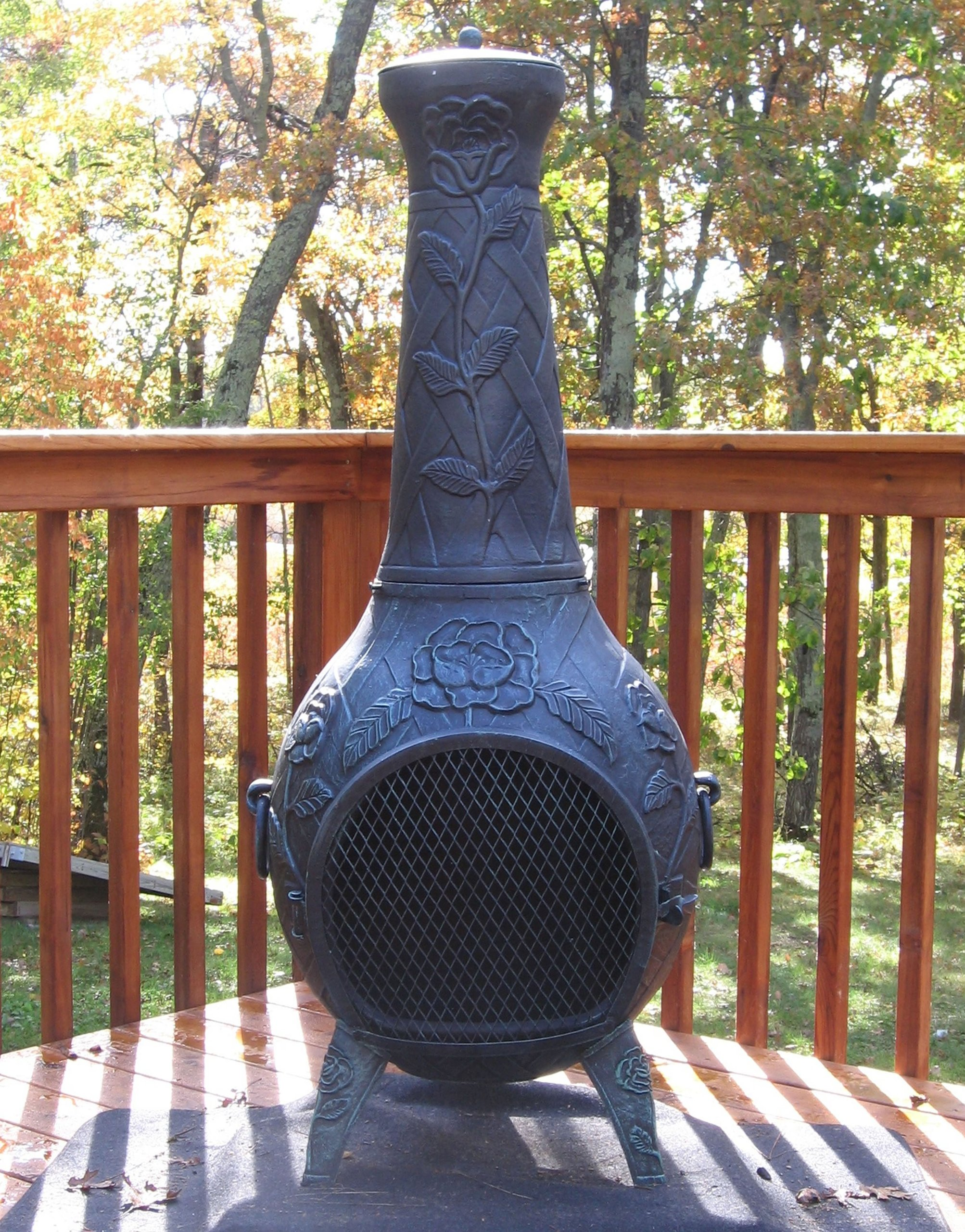 The Blue Rooster Co. Rose Style Cast Aluminum Wood Burning Chiminea in Antique Green.