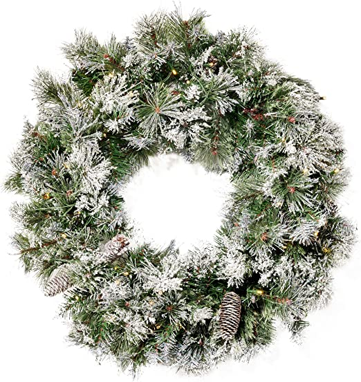 Amazon Com Christopher Knight Home 307397 24 Mixed Spruce Christmas Wreath W 50 Warm White Led Lights Flocked Snow And Glitter Branches Pinecones Battery Operated Timer Included Green Home Kitchen