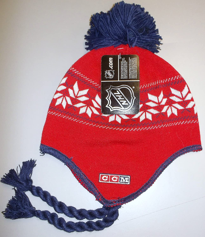 e9715b418f8 Amazon.com   CCM Washington Capitals Team Classics Tassel Knit with POM NHL  Hat - Osfa - KZG84   Sports Fan Beanies   Sports   Outdoors