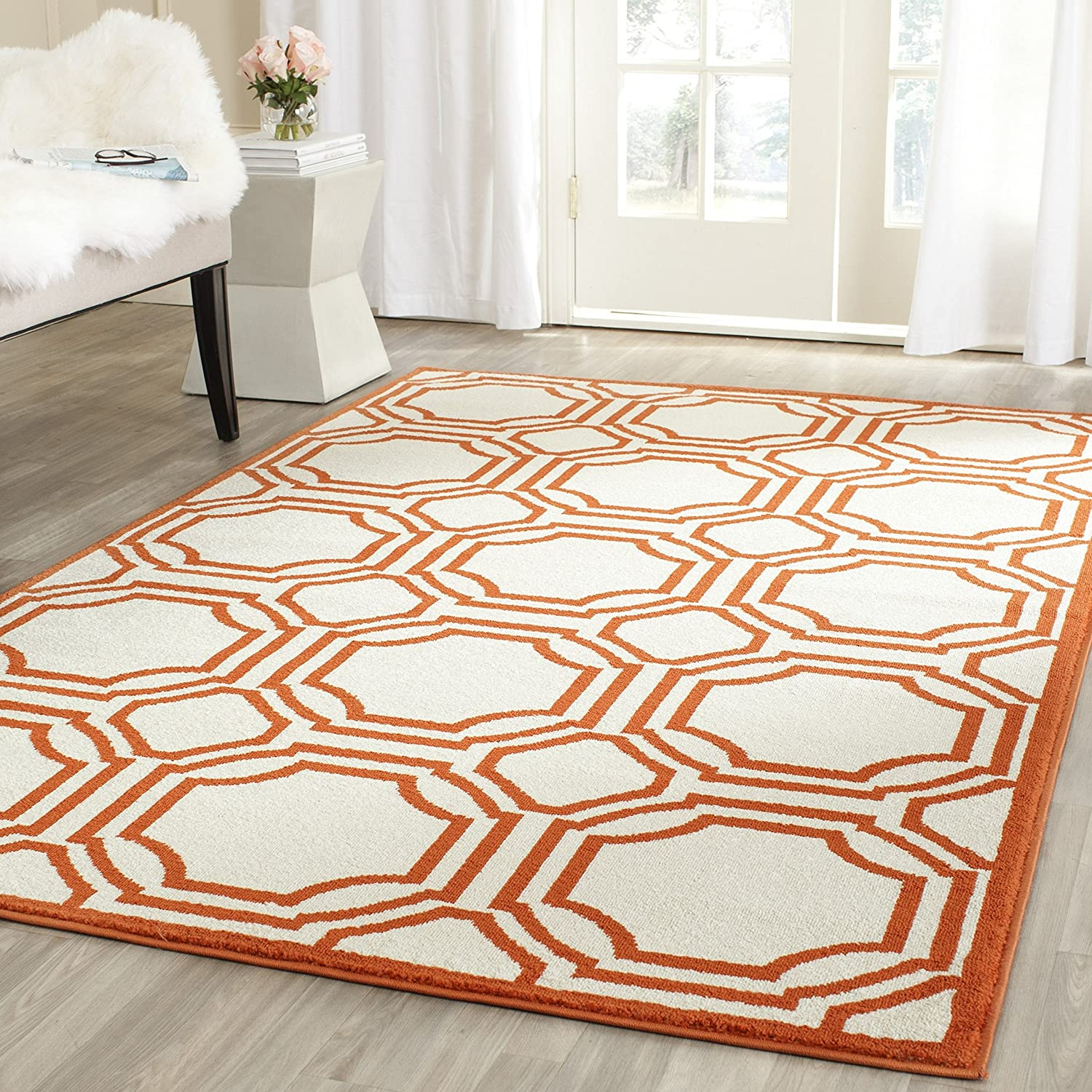 Amazon Safavieh Amherst Collection AMT411F Ivory and Orange