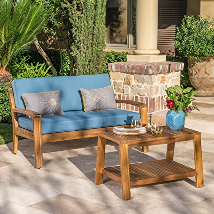 Phenomenal Christian Outdoor Teak Finished Acacia Wood Loveseat And Coffee Table Set With Blue Water Resistant Cushions Evergreenethics Interior Chair Design Evergreenethicsorg