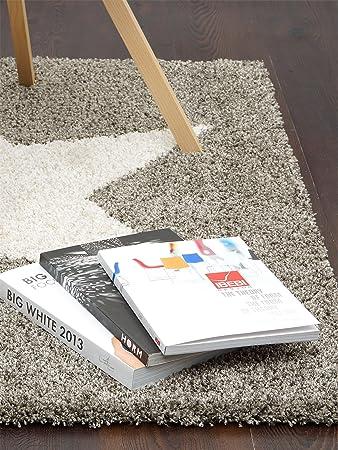 Hochflor Teppich aus Polyester handgetuftet königsblau mit metallic Effekt