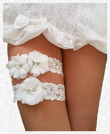 4a497ed3a Amazon.com  Ivory Wedding Keepsake Toss Garters Lace Vintage White Bridal  Prom - Set of 2  Clothing