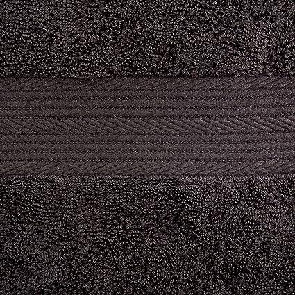 AmazonBasics - Juego de toallas (colores resistentes, 2 toallas de baño y 4 toallas de manos), color negro: Amazon.es: Hogar