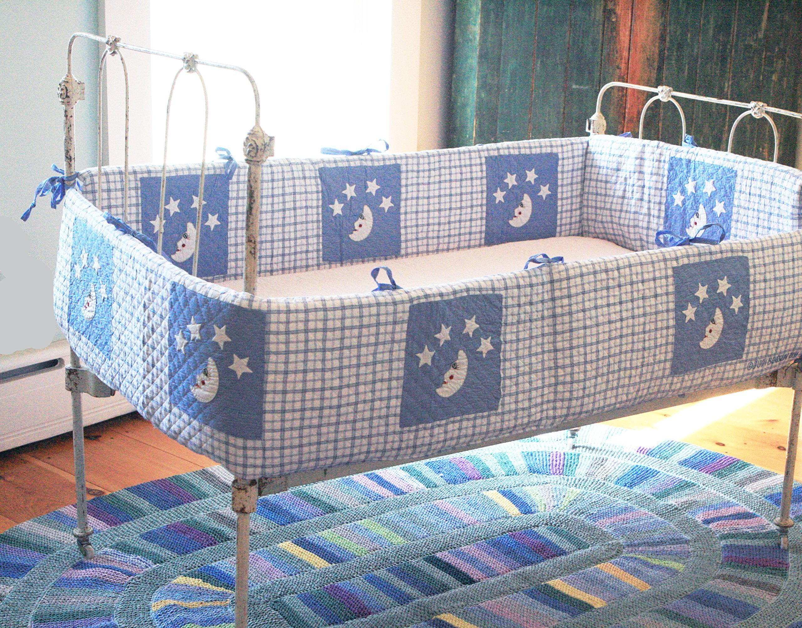 Designed by Judi Boisson,'' Mr. Moon'' Bumper with his Sky Blue Eyes was able to see all the Stars Above and Beyond. Hand Quilted, Appliqued, and Embroidered. Reversible. Cotton.